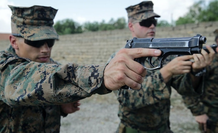 a picture of The Beretta M92FS held by a US Marine