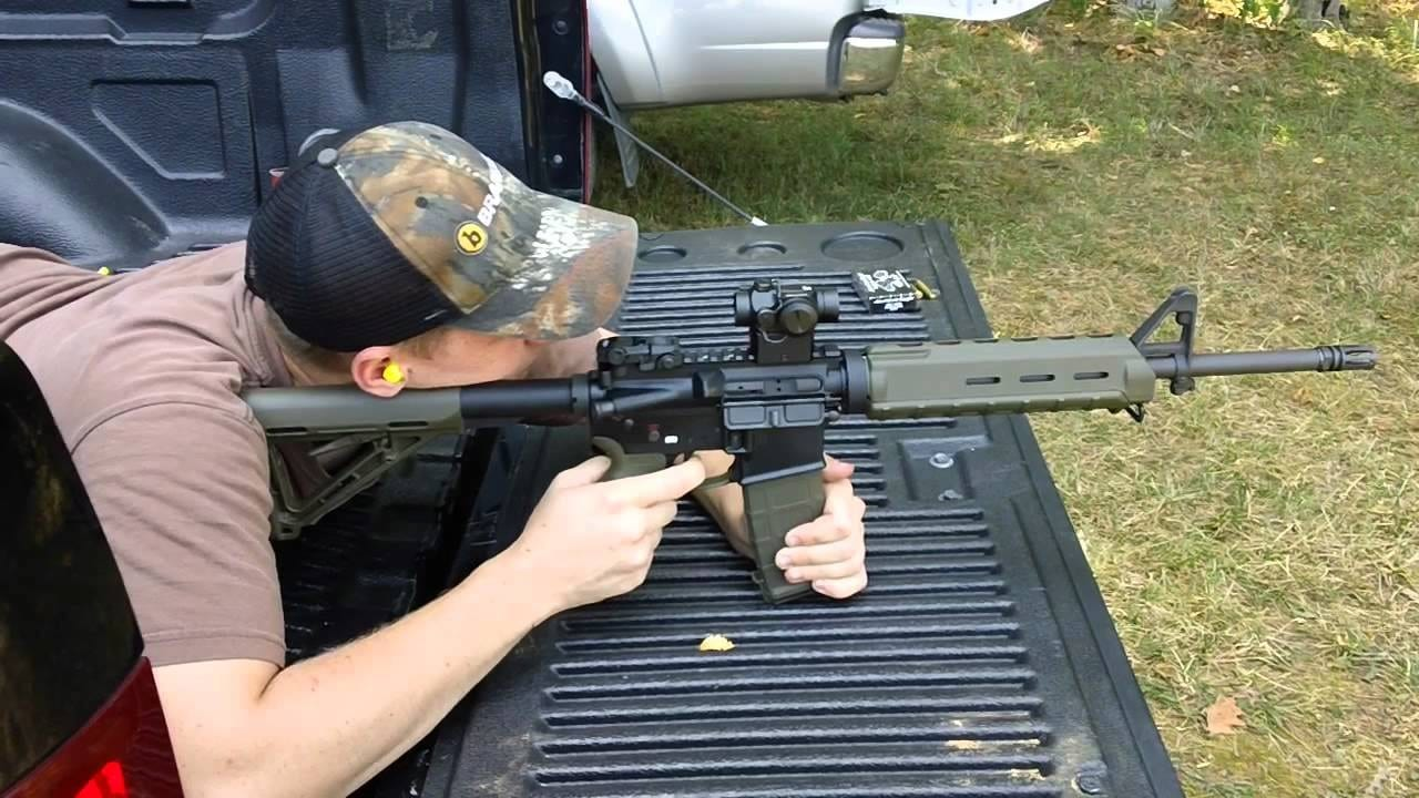 image of a man sighting his rifle with Vortex SPARC II AR-15 scope