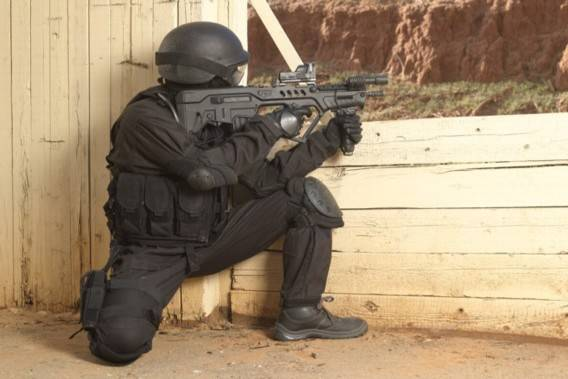 image of a tactical unit using bullpup rifle