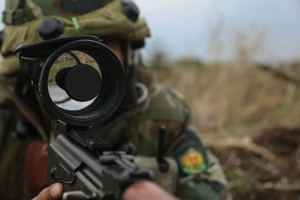 image of a romanian soldier with night vision scope