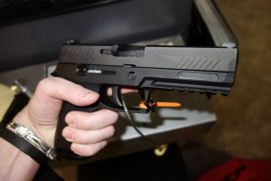 a picture of the SIG P320 Nitron at a gunshow