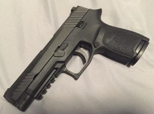 a picture of a SIG P320 with a full slide and a compact frame