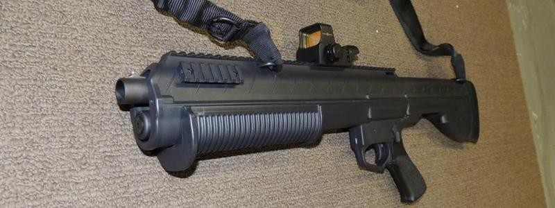 a picture of the Sightmark Ultra Shot mounted on a bullpup shotgun