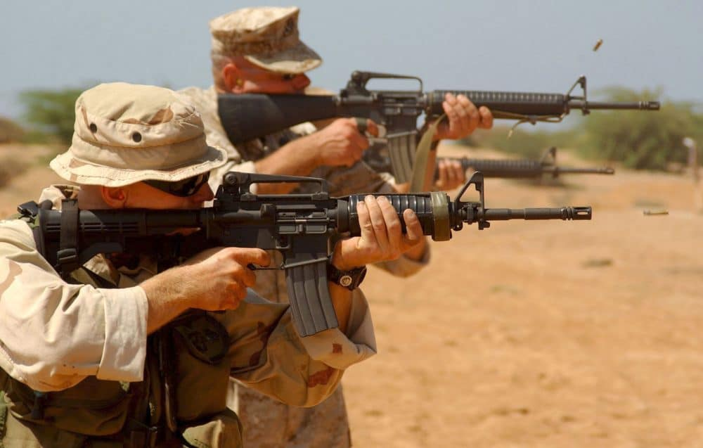 men firing an ar15 rifle
