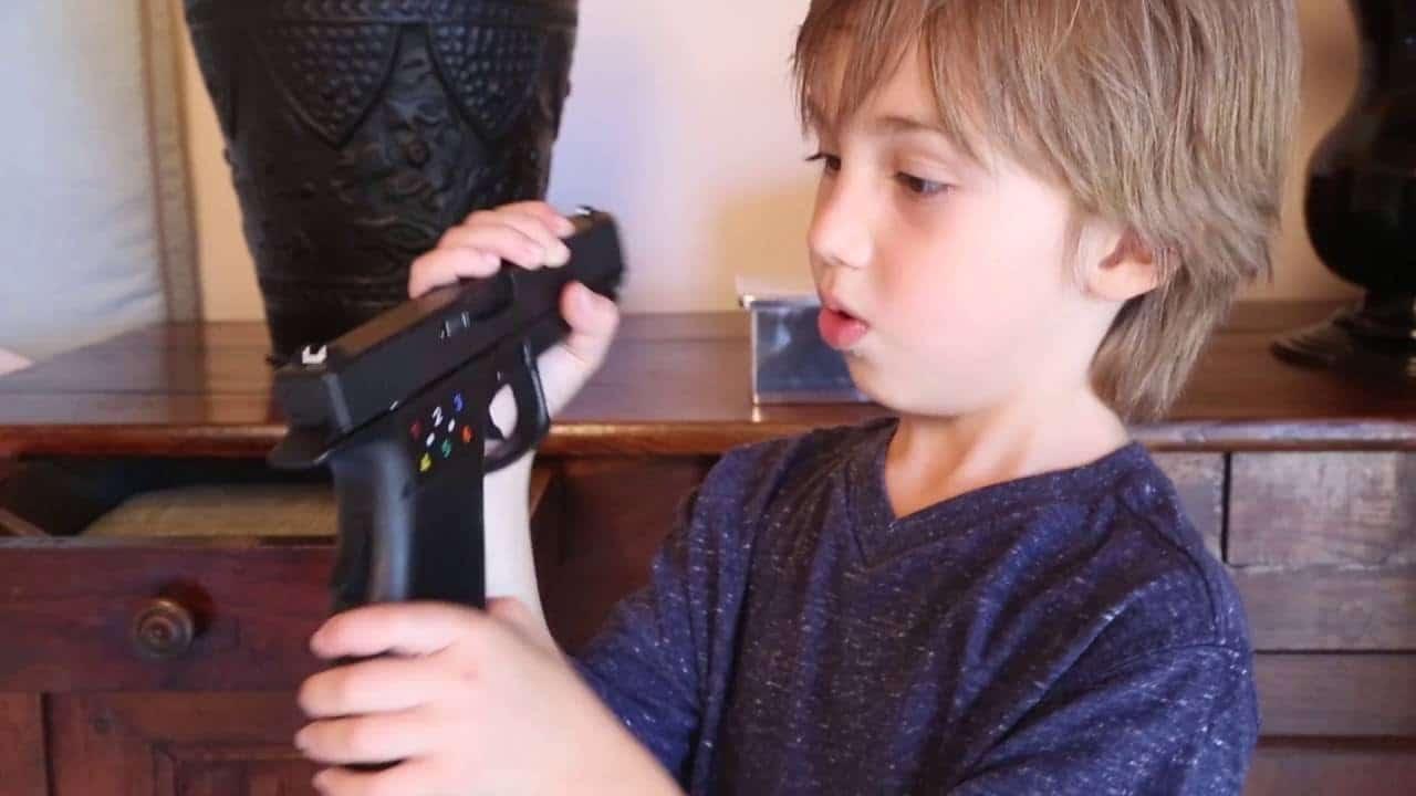 a kid curios to a gun