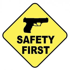 image of a gun safety first signage