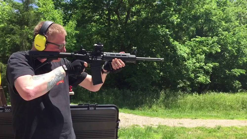 image of a man standing with his Ruger AR-556 for target shooting