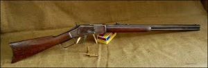 A picture of the .44-40 Winchester Rifle with ammo