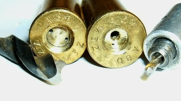 a picture of a Berdan primed and a Boxer primed cartridge