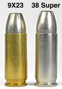 a picture of 9x23 Winchester and 38 Super cartridges