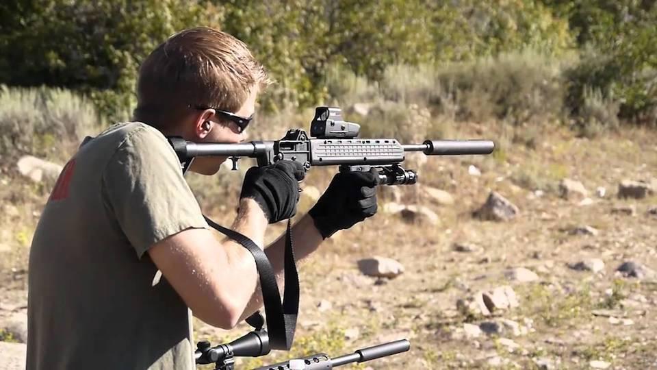 image of a man using Kel-Tec Sub-2000 in shooting