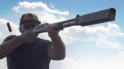 image of a man using a shotgun suppressor in shooting
