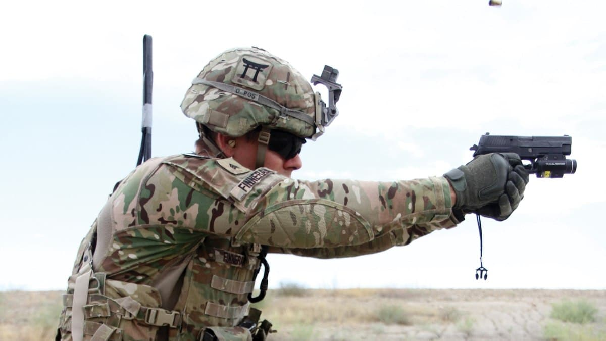 a picture of a soldier holding a sig p320