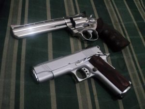 a picture of a Taurus 689 and a Norinco NP27 custom
