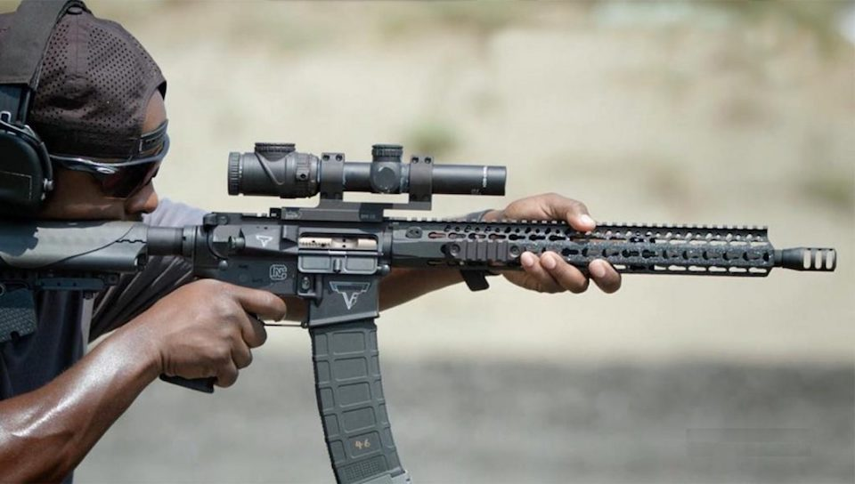 image of a man aiming using an ar-15 scope