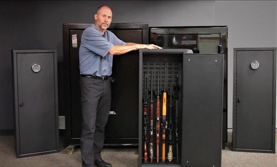 image of a man showcasing gun safes