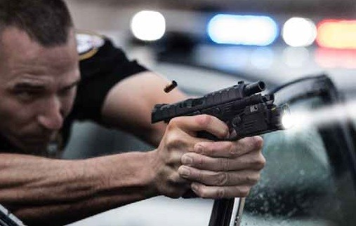 a picture of a guy shooting a Beretta APX