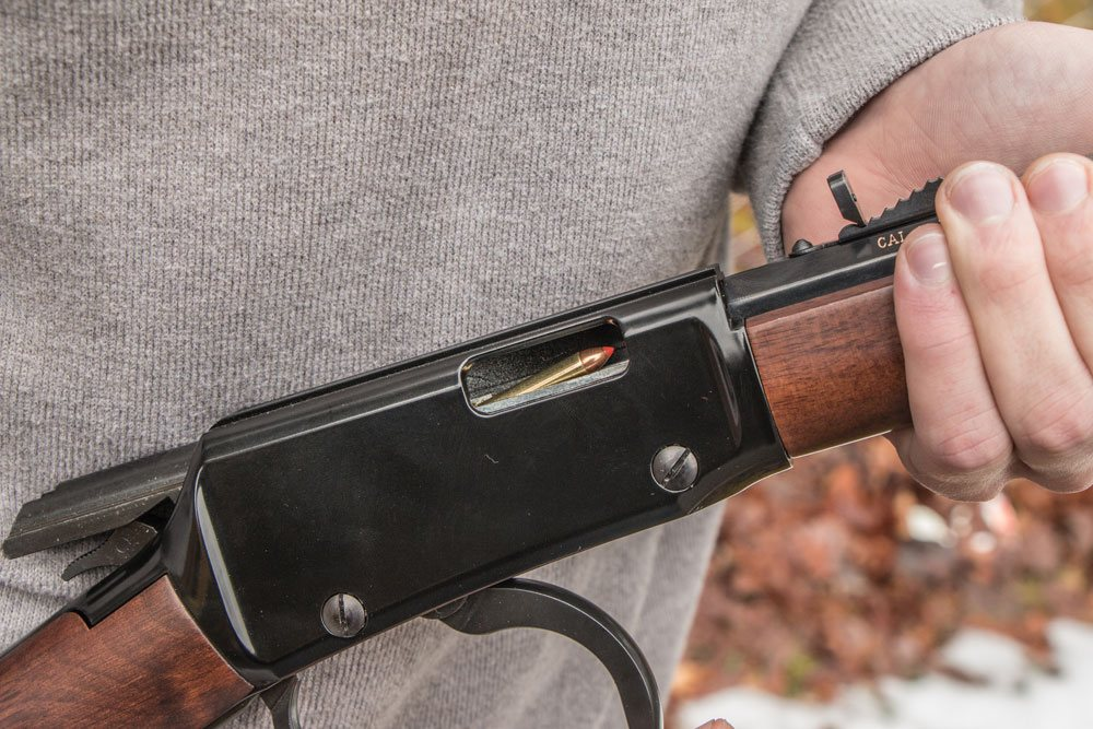 a picture of a Henry lever-action octagon barrel rifle