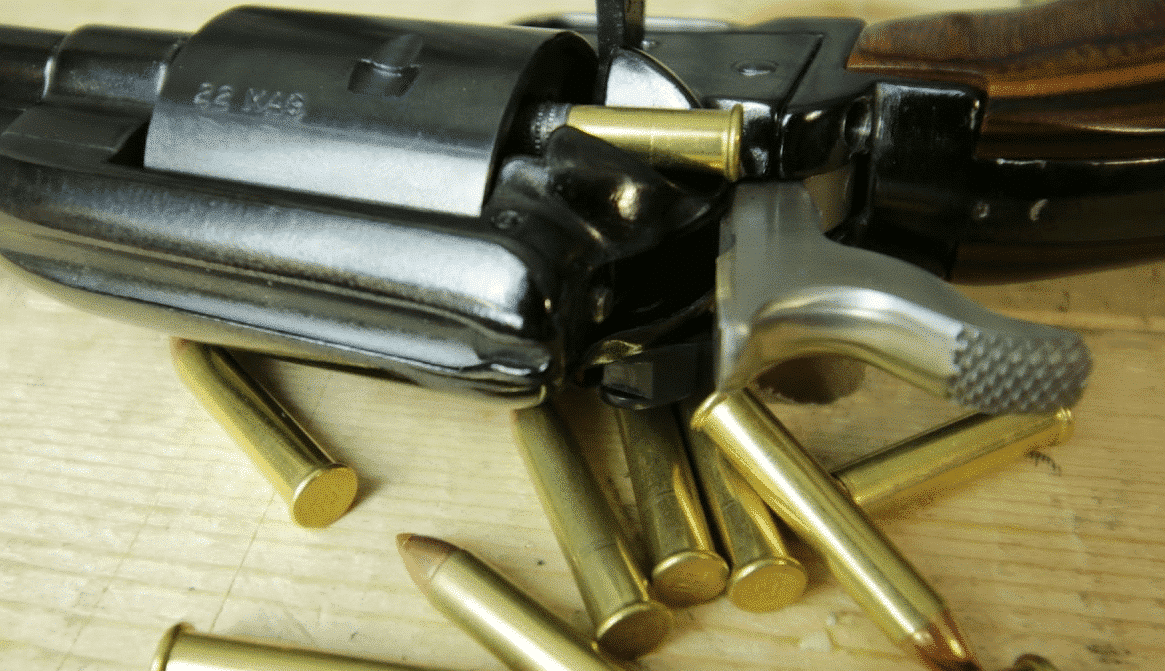a picture of a Single action .22 magnum revolver loaded with .22 lr ammo