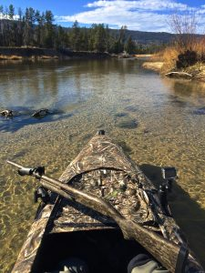 duck hunting kayak and rifle