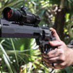 A hunter holding a Taurus 44 Magnum Raging Hunter revolver