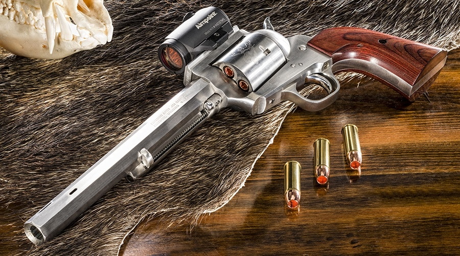 A picture of a Freedom Arms Model 83 revolver with 454 Casull cartridges