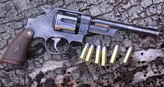 A picture of a S&W Triple Lock with 44 Special cartridges