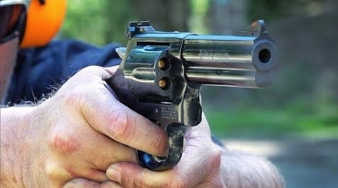 a picture of someone shooting a 357 magnum revolver
