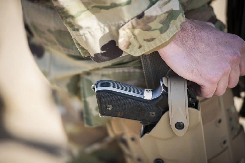tactical holster worn by a soldier