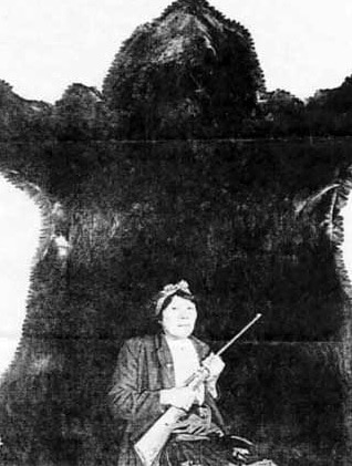 Bella Twin and the bear she killed with .22 Long