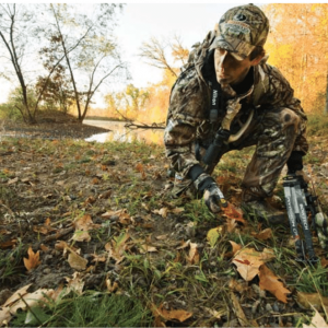 image of a bowhunter tracking for something