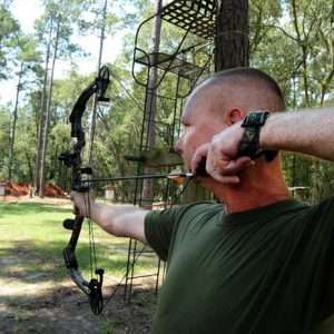 image of a man using a bow hunting sight