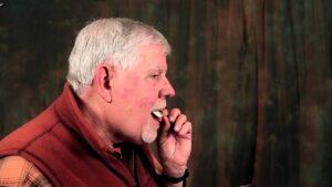 a man using a Turkey Mouth Call