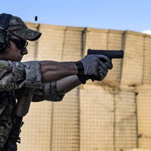 A picture of a man shooting a Glock 17 Gen 5